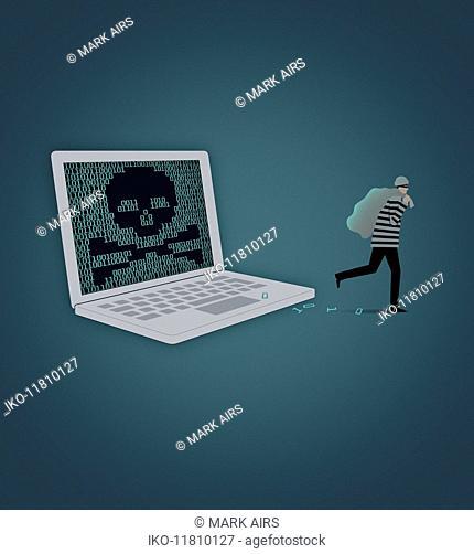Burglar stealing data from laptop computer screen