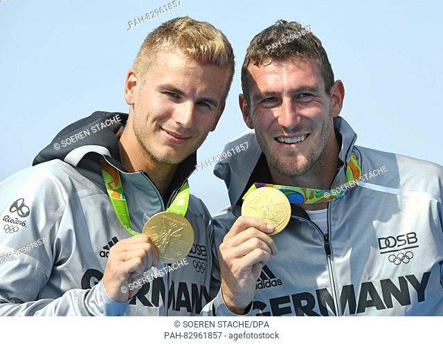 Gold medalists Sebastian Brendel (R) and Jan Vandrey of Germany celebrate at the medal cermony after the Men's Canoe Double 1000m Final of the Canoe Sprint...