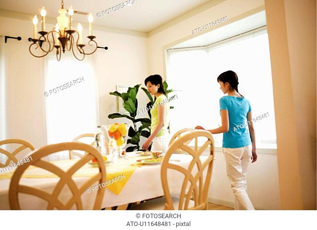 Young Women In Dining Room