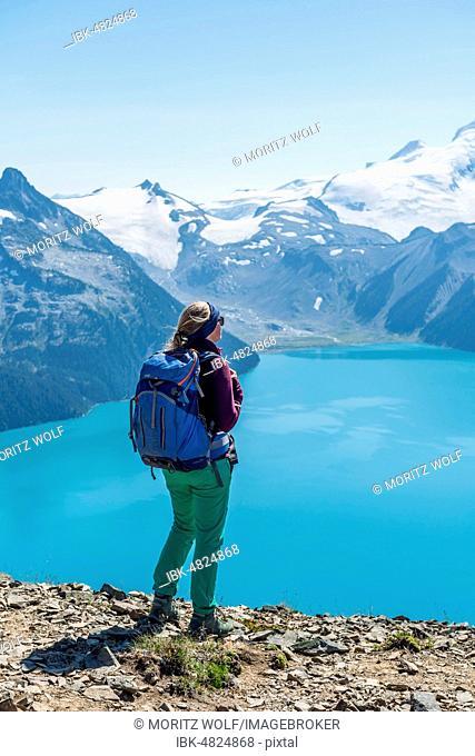 View from Panorama Ridge Hiking Trail, Hiking on a Rock, Garibaldi Lake, Turkish Glacial Lake, Guard Mountain and Deception Peak, Glacier