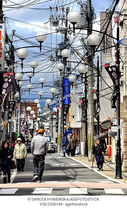 full of cables and street lamps street of Fushimi-ku, ward of Kyoto, Kansai Region, Japan