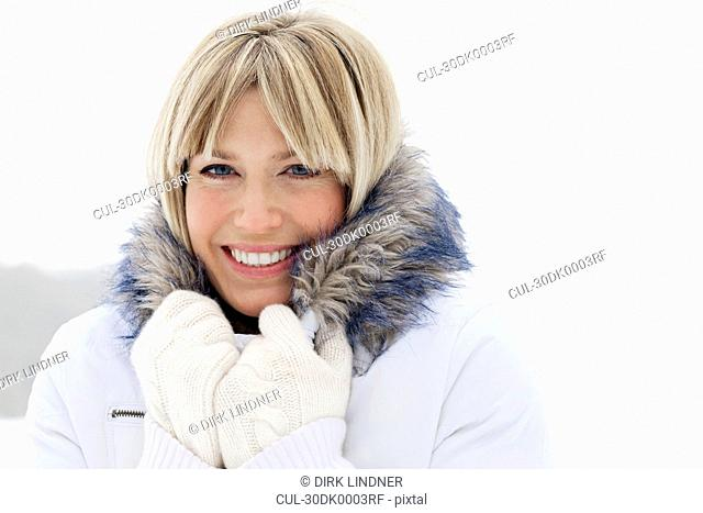 Head shot of woman in the snow