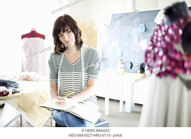 pretty, clothing designer doing some sketches