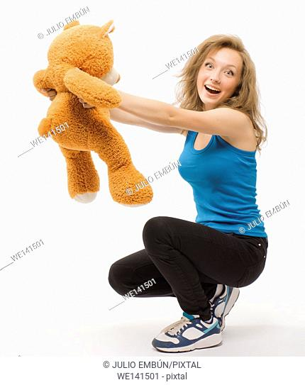 young girl playing with her teddy bear