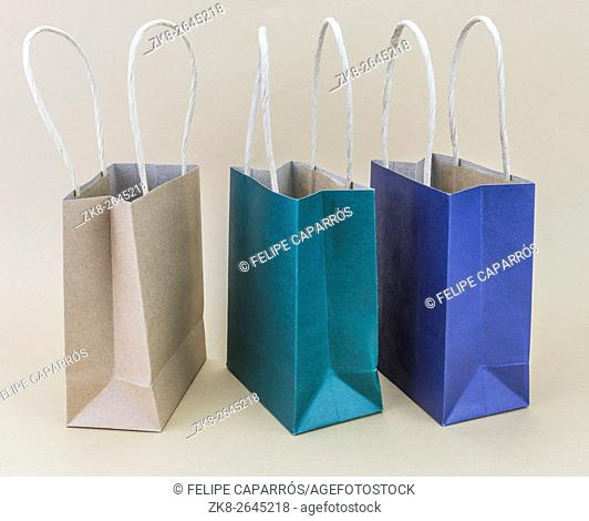 Paper shopping bag isolated on brown background