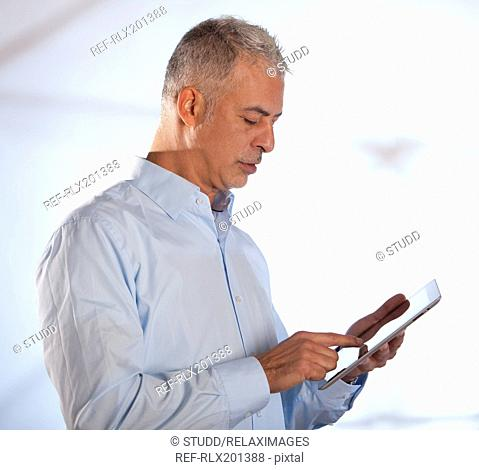 Man typing on using tablet PC iPad touch screen