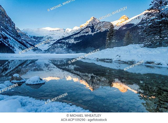 Winter reflection, outlet stream, Lake Louise, Banff National Park, Alberta, Canada