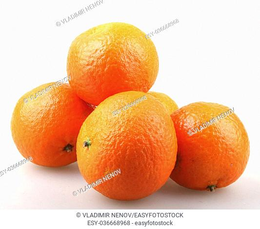 Fresh tangerine fruits on a white background