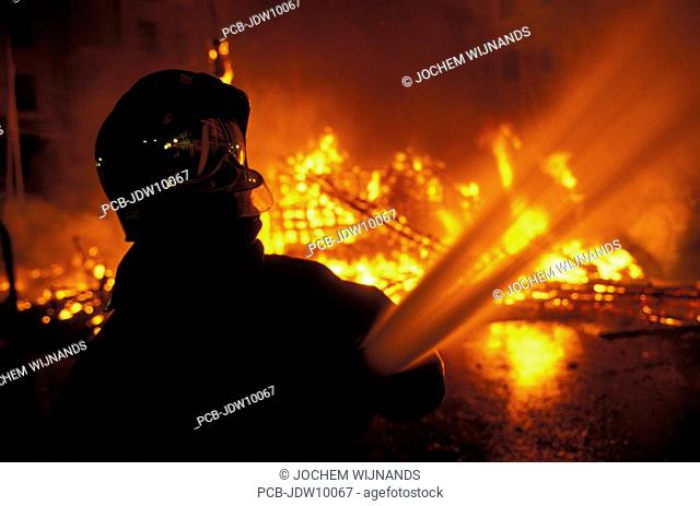 Valencia, firemen controlling the fire at the burning of the ninos the Las Fallas festival