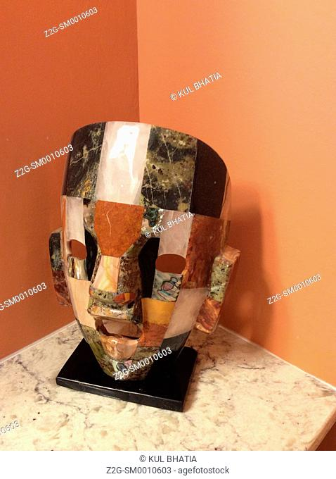 An elegant face mask made of colourful stones, Ontario, Canada