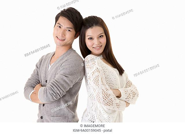 Young couple standing and smiling at the camera
