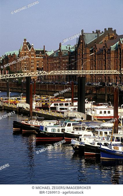 View over boats towards the brick facades of historic warehouses, Speicherstadt, Kehrwieder, inland port, port of Hamburg, Hanseatic City of Hamburg, Germany