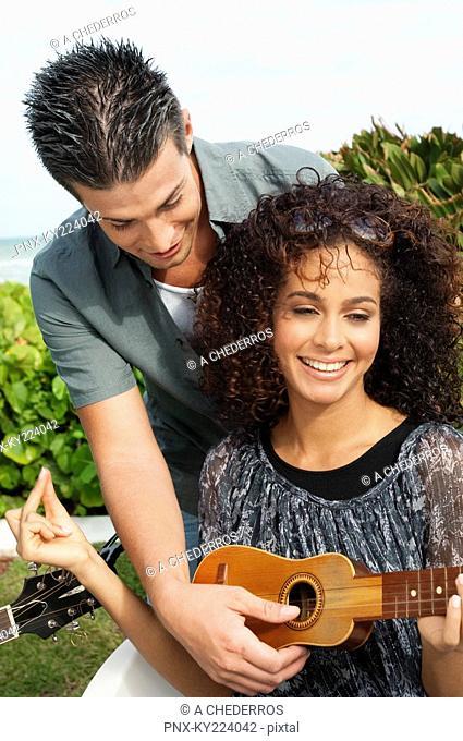 Couple playing ukulele
