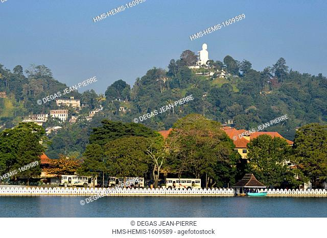 Sri Lanka, Central Province, Kandy District, Kandy, Border of the lake with the statue of Bouddha Bahiravokanda Vihara in the background