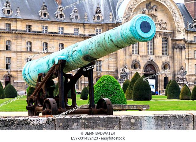 An ancient cannon at Les Invalides in Paris, France, on a beautiful day in spring