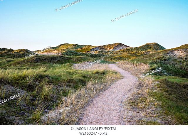 Netherlands, North Holland, Julianadorp. Walking path through the dunes