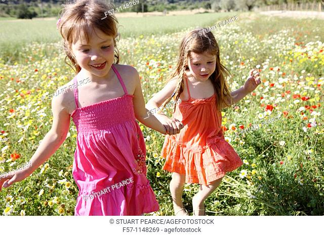 Two little girls in meadow