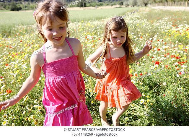 Two little girls in meadow