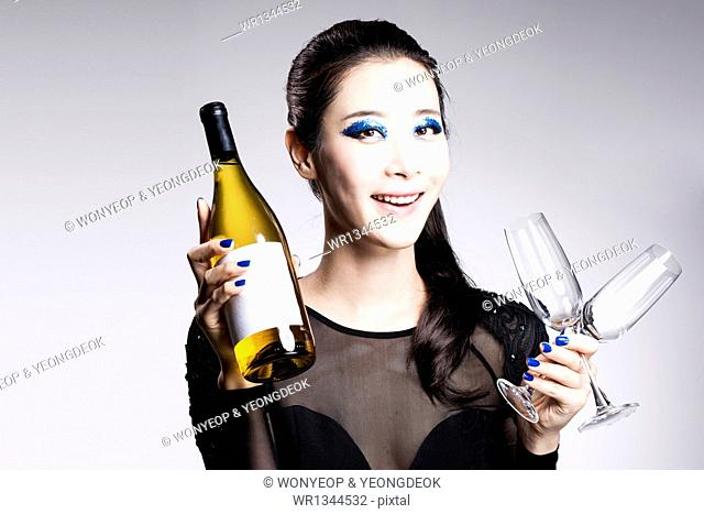 a woman with wine and heavy blue make up