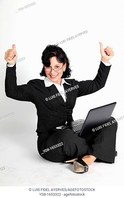 Female executive working with the laptop
