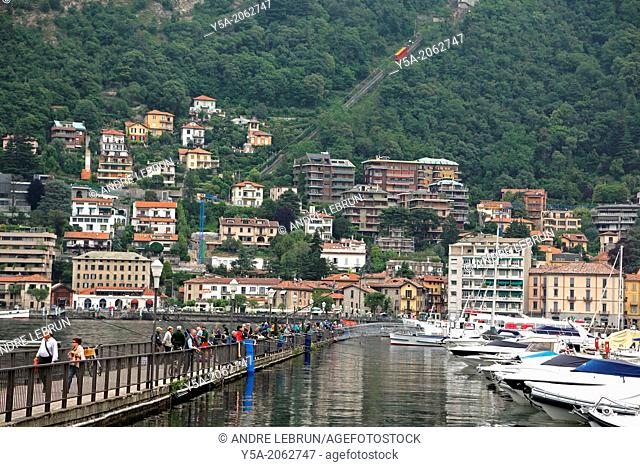 People fishing in the lake in Como in northern Italy