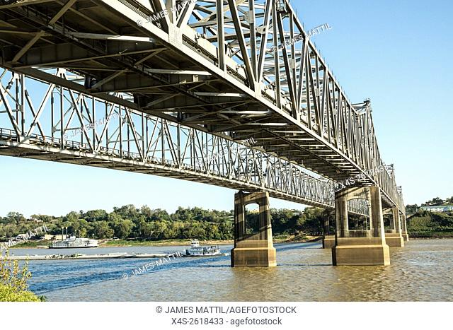 A tug boat pushes a barge beneath the bridge over the Mississippi at Natchez, TN. Tub