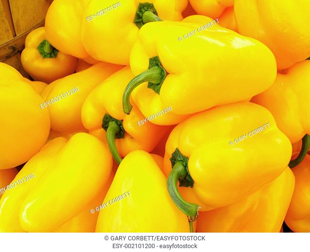 a pile of yellow peppers