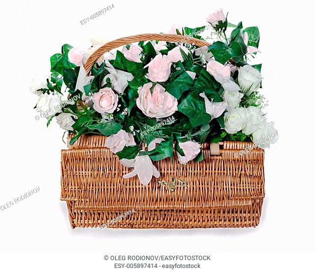 colorful flower bouquet arrangement from white and pink roses centerpiece in a wicker gift basket isolated on white background