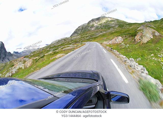 Car driving down roads in Norway