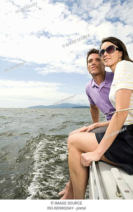 Couple traveling on a sailing boat