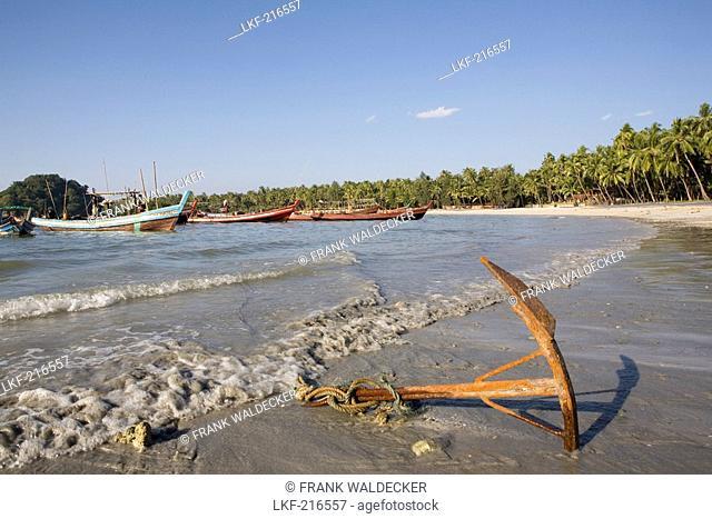 Anchor and fishing boats in Ngapali Beach, Gulf of Bengal, Rakhine State, Myanmar, Burma