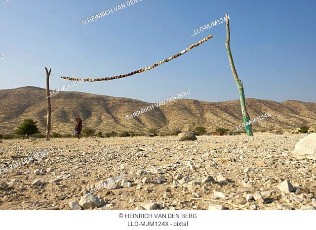 Rustic rural soccer field made of tree branches and cans, Epupa falls area, Kaokoland, Namibia
