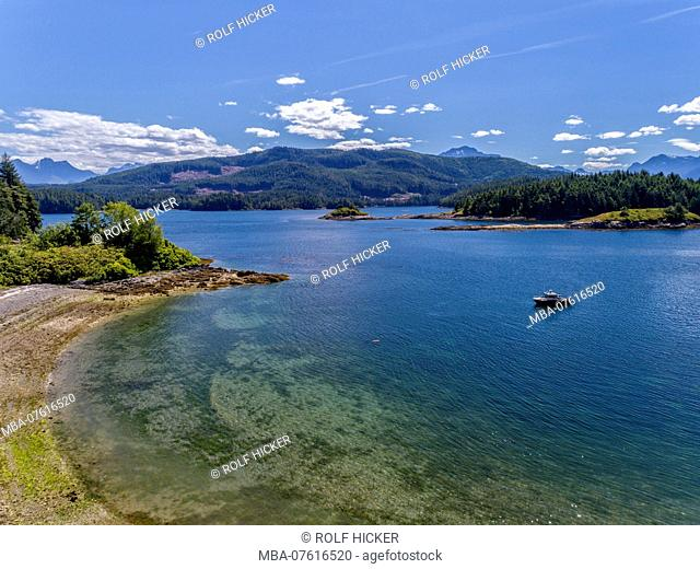 The Ambient Light tour boat near a beach inside the Broughton Archipelago Marine Park, First Nations Territory, British Columbia, Canada