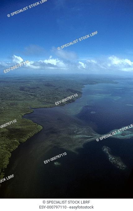 Aerial view of barrier reef and forested main island of Babelthaup, Palau Palau Belau, Pacific Ocean