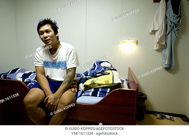 An Indonesian Seaman or sailor, waking up in his cabin on the container-vessel MV Flintercape, during a journey from Rotterdam, Netherlands, to Sundsvall