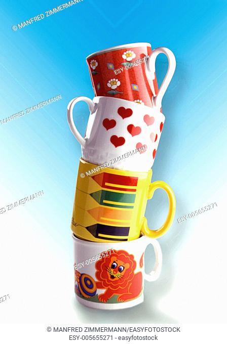 four stacked cups with funny, colorful decor