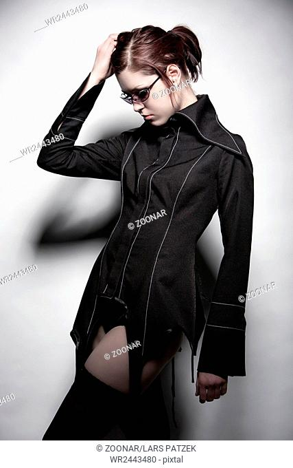 Young woman in designer jacket