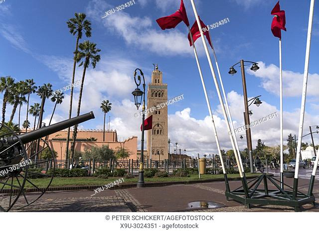 moroccan flags, canon and Koutoubia Mosque minaret, Marrakesh, Kingdom of Morocco, Africa