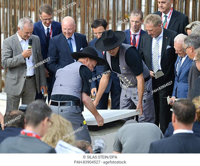 Foremen from the company Zueblin hold the foundation stone at the groundbreaking for the new central railway station as part of the Stuttgart 21 railway project...