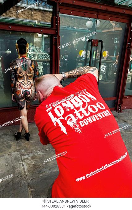 England, London, London Tattoo Convention, Convention Photographer Taking Picture of Tattooed Woman