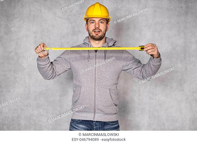 builder holds a folding rule