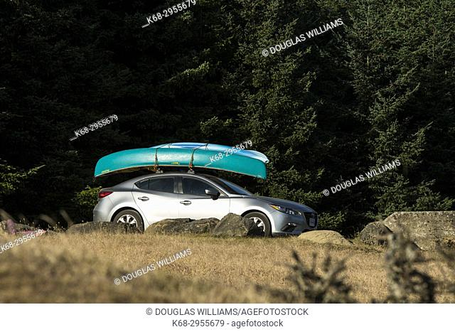 car with canoe on Saturna Island, BC, Canada