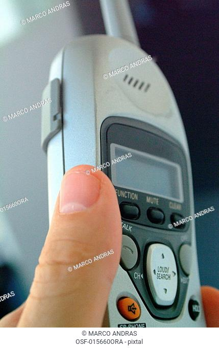 a person holding a wireless telephone