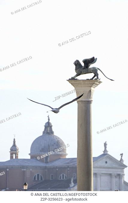 Venice, Veneto, Italy: The famous ancient winged lion sculpture at Saint Marks square