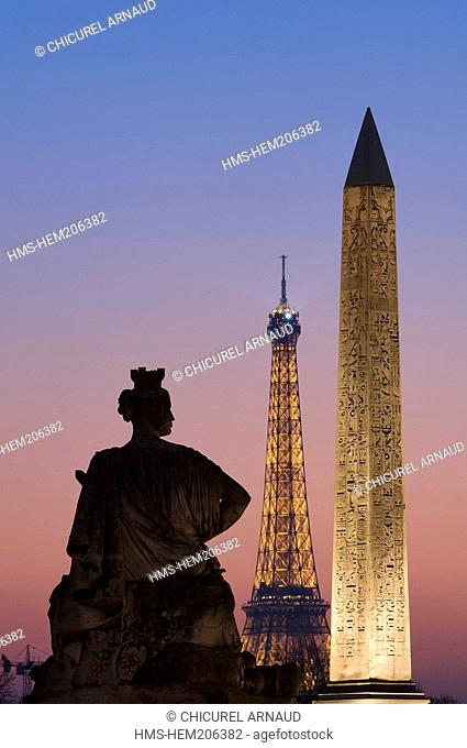France, Paris, Place de la Concorde square, Obelisk, and the Eiffel Tower illuminated lighting of the Eiffel Tower by Pierre Bideau, reproduction rights