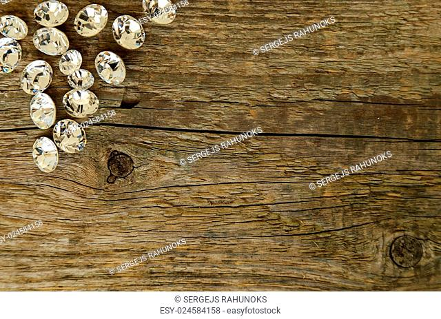 Jewellery. Few crystals on the wooden table