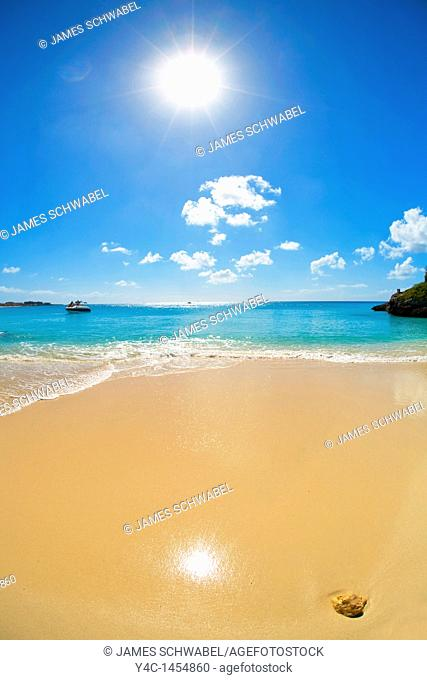 Sun shining on beach on the caribbean island of Anguilla in the British West Indies
