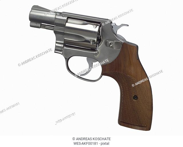 Revolver against white background, close up