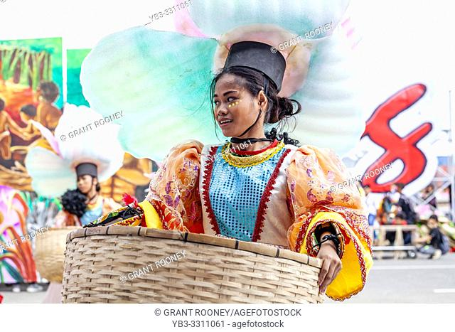 Iloilo City, The Philippines. 27th January 2019. Philippinos dressed in tribal costume take part in a spectacular street procession and dance display on the...