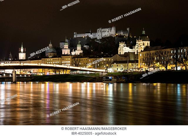 Cityscape, night view over the Salzach with Hohensalzburg Fortress and Cathedral, Salzburg, Austria